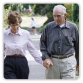 Picture of a man and a woman walking while holding hands